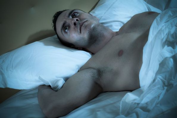 20433764 - an handsome and muscular man thinking on a bed