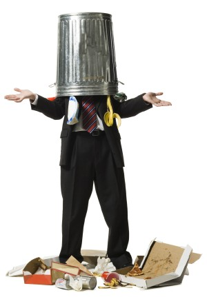 Businessman with trash can on head